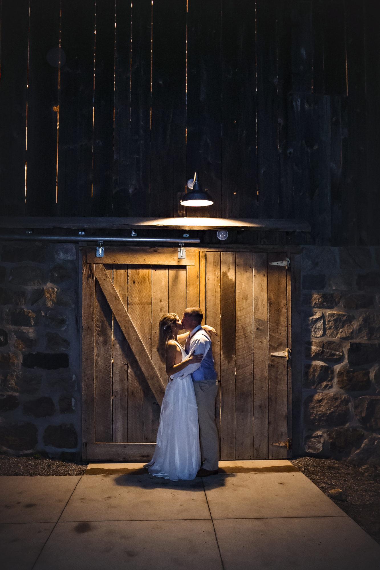 Starry Night Barn and Studios Wedding couple kissing