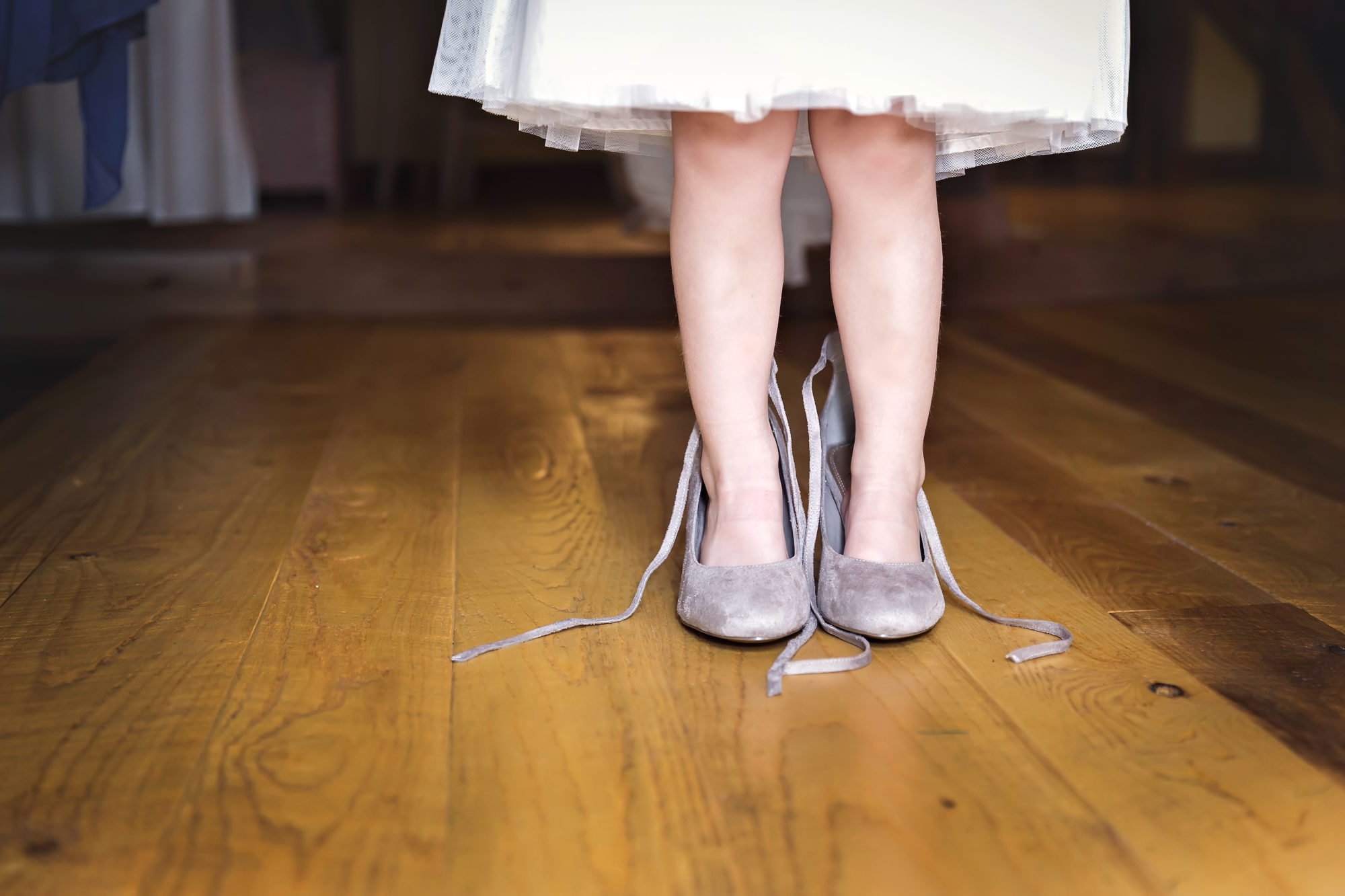 Flower girl in Bride's shoes at Starry Night Barn and Studios
