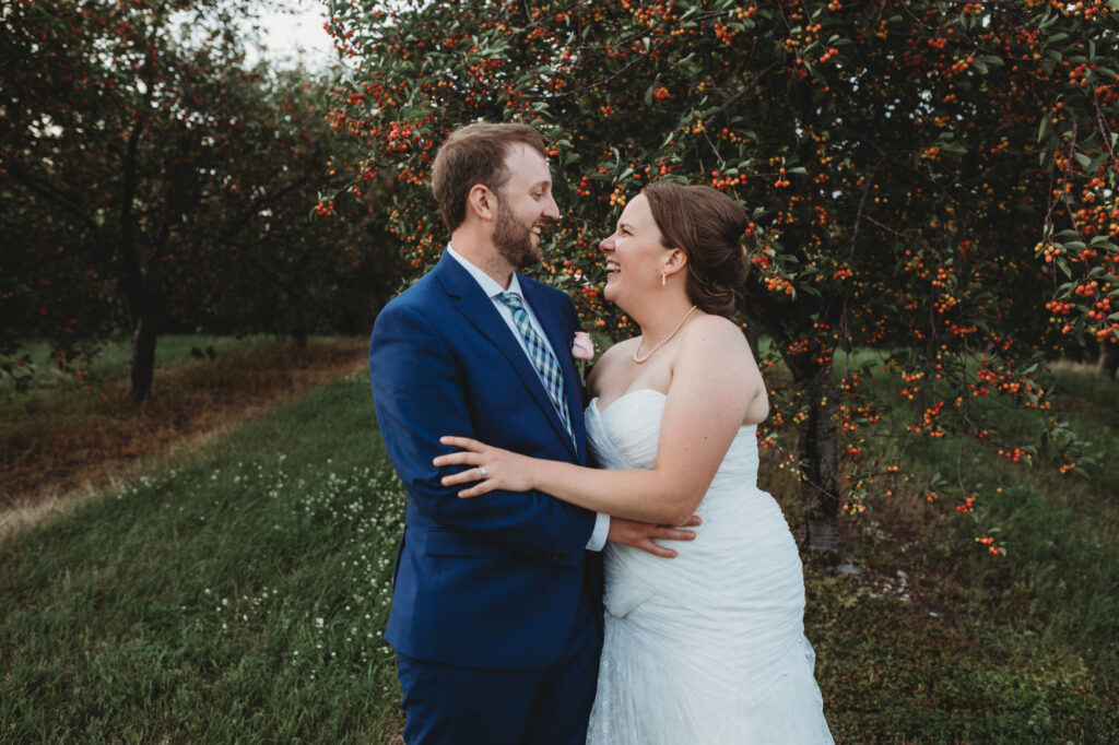 Starry Night Barn and Studios Wedding Couple in orchard