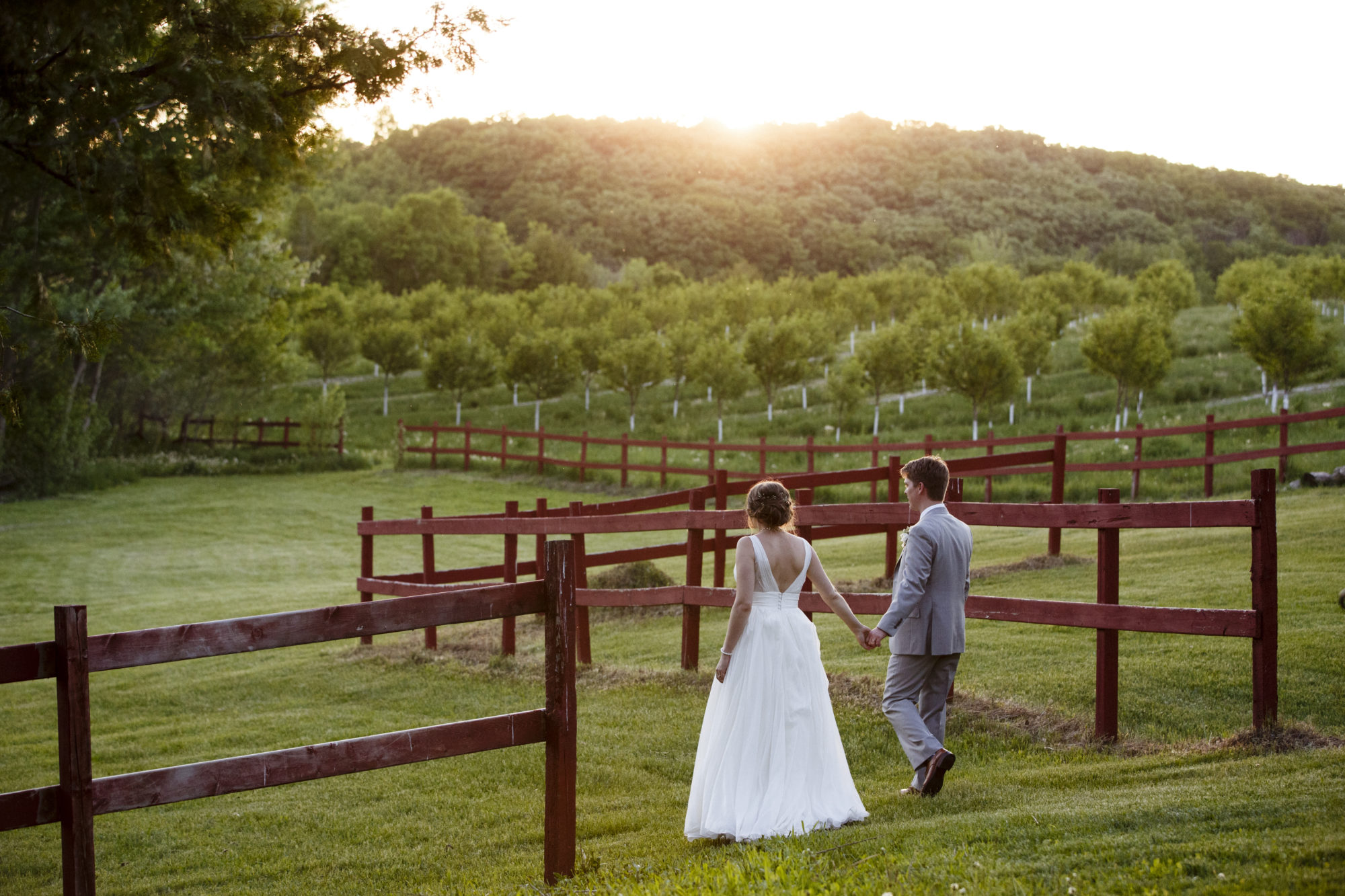 Starry Night Barn and Studios Wedding couple in field