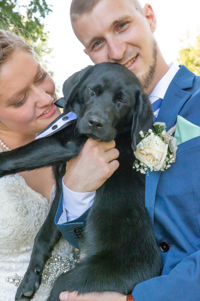 Married couple with puppy at Starry Night Barn and Studios Wedding