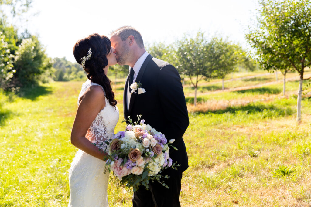 Married couple kiss at Starry Night Barn and Studios Wedding