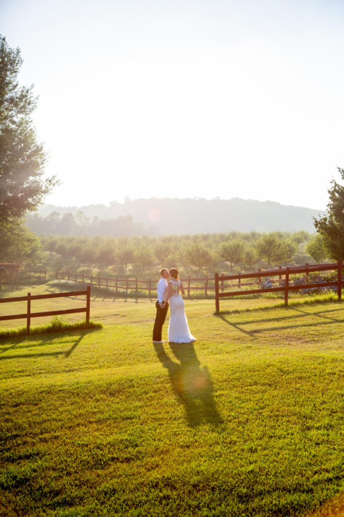 Married couple in Starry Night Barn and Studios field
